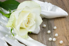 Wedding glove, pearls and white rose Royalty Free Stock Photography