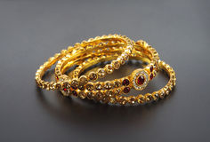Wedding gold bracelets Royalty Free Stock Photo