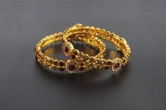 Wedding gold bracelets Stock Photos