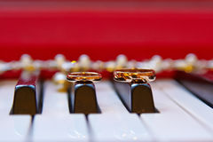 Wedding gold rings, background piano Royalty Free Stock Photo