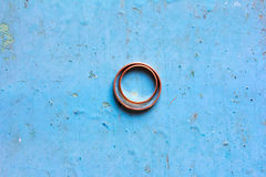 Wedding gold rings on a blue background Stock Photo