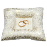 Wedding gold rings bride and groom on decorative pillow. Stock Image