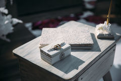 Wedding gold rings on a decorative white box, lie on the table. Jewelry concept Stock Photography