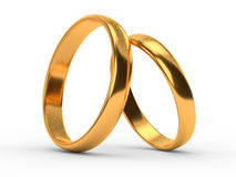 Wedding gold rings lie on each other Stock Photos