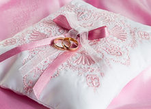 Wedding gold rings on a pillow Royalty Free Stock Photo