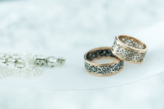 Wedding gold rings on white ribbon Stock Photo