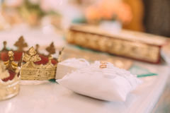 Wedding golden rings on a pillow in the old church Stock Image