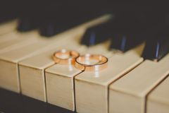 Wedding golden rings on vintage piano Royalty Free Stock Photos