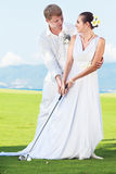 Wedding golf. Bride and groom are playing golf at wedding day Royalty Free Stock Photos