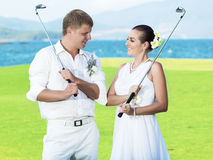 Wedding golf. Bride and groom are playing golf at wedding day Stock Images