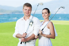 Wedding golf. Bride and groom are playing golf at wedding day Stock Photos