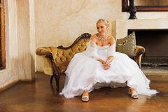 Wedding gown. Waiting bride stock photo