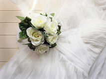 Wedding gown and bouquet Royalty Free Stock Photography