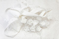 Wedding gown and decorated with white roses. White wedding gown and decorated with white roses stock image