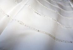 Wedding Gown Detail. Close up of white wedding gown beaded pattern Stock Images