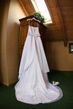 Wedding gown hanging. White wedding dress hanging pre wedding Stock Photo