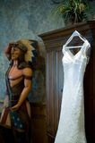 Wedding gown hanging near a cigar indian Stock Photos