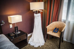 Wedding Gown and Shoes Stock Images