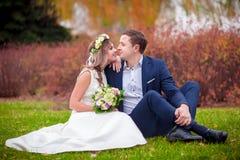 Wedding grass kiss. Bride groom Royalty Free Stock Photo