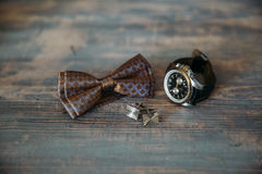 Wedding groom accessories, details of clothes, bow tie, cuff links, wristwatches. Royalty Free Stock Photos