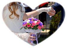 Wedding. Groom and bride with a bouquet of flowers Stock Image