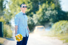 Wedding groom with flowers bouquet Royalty Free Stock Images