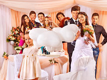 Wedding group people in banquet hall. Royalty Free Stock Photos