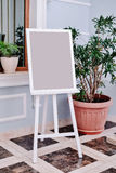 Wedding guest list on wooden easel Royalty Free Stock Photos