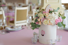 Wedding guest table decorated with bouquet and candlesticks Royalty Free Stock Image