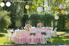 Wedding guest table decorated with bouquet and cloth Stock Image