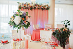 Wedding guest table decorated with bouquet and settings Royalty Free Stock Photography