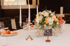Wedding guest table decorated with bouquet and settings Royalty Free Stock Image