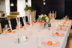 Wedding guest table decorated with bouquet and settings Stock Photos