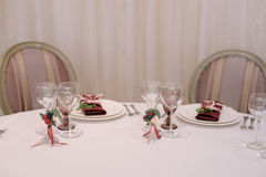 Wedding guest table decorated with glasses and settings Royalty Free Stock Photography