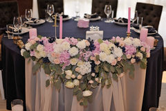 Wedding guest tables decorated with bouquet and settings stock photo