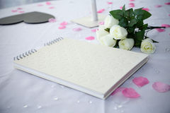 Wedding guestbook. Next to flowers stock photo