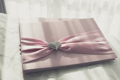 Wedding Guestbook. Wedding Notebook for well wishers on bed royalty free stock photos
