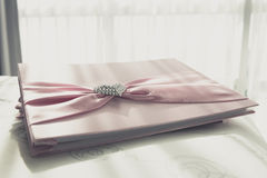 Wedding Guestbook. Wedding Notebook for well wishers on bed royalty free stock images