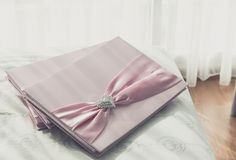 Wedding Guestbook. Wedding Notebook for well wishers on bed stock images