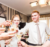 Wedding guests clinking glasses Royalty Free Stock Images