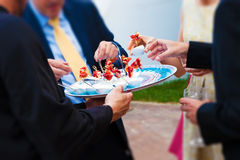 Wedding guests eating an appetizer Royalty Free Stock Photography