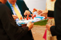 Wedding guests eating an appetizer Stock Image