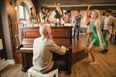 Wedding Guests Having Fun With The Piano royalty free stock images
