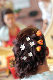 Wedding hairstyle. Beautiful wedding hairstyle with fresh flowers Stock Photos
