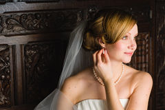 Wedding hairstyle. Beauty wedding hairstyle - Bride sitting on an old bench Stock Images