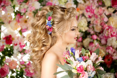 Wedding hairstyle a young girl. Bride. Woman with Flowers in her Stock Photos