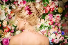Wedding hairstyle a young girl. Bride. Woman with Flowers in her Royalty Free Stock Photo