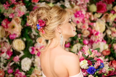 Wedding hairstyle a young girl. Bride. Woman with Flowers in her Royalty Free Stock Photos
