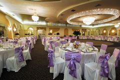 Wedding hall. Wide, spacious and stylish wedding or special events hall with chandeliers royalty free stock images