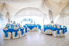 Wedding hall. Bright wedding hall with blue coloured chairs Stock Images